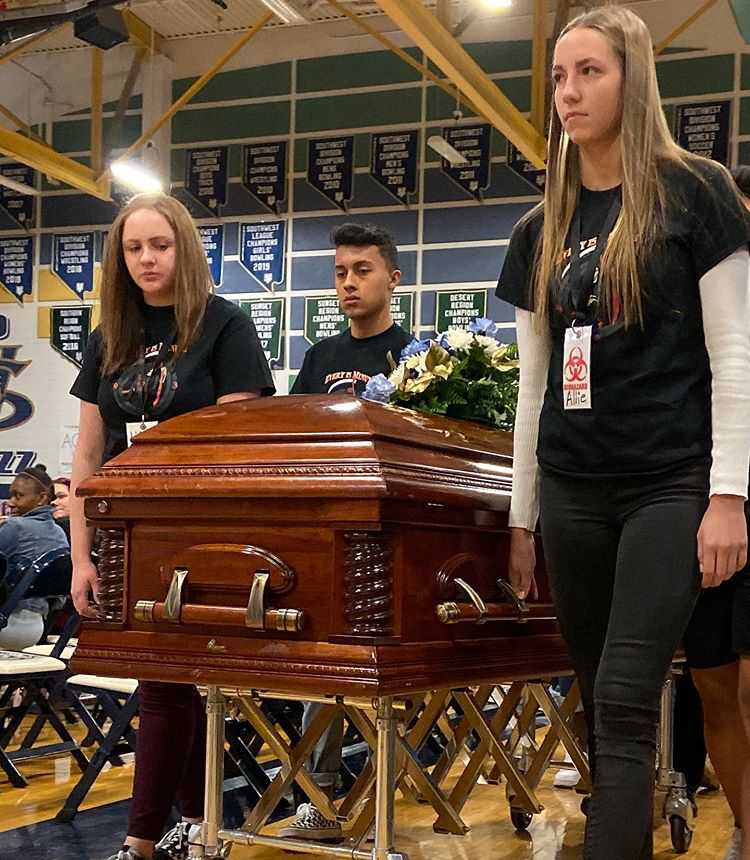 Juniors and seniors attend a mock funeral as part of a drunk driving presentation