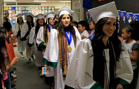 In this 2018 photo, Spring Valley Graduates walk through an elementary school. Credit: Las Vegas Review-Journal